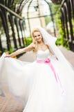 Elegant bride dancing and posing Stock Images