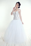 Elegant bride with dark hair in luxurious wedding dress Stock Images