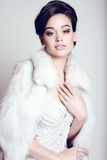 Elegant bride with dark hair in luxurious wedding dress Royalty Free Stock Image