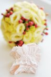 Elegant bride garter Stock Photos