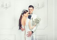 Elegant bride and groom embracing sensually stock image