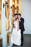 Elegant bride and groom in luxury interior Stock Image