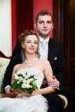 Elegant bride and groom in luxury wedding palace stock photos