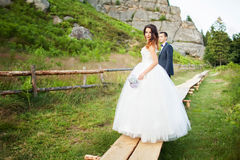 Elegant bride and groom posing together outdoors on a wedding da Royalty Free Stock Photography