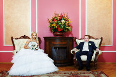 Elegant bride and groom in wedding palace stock image