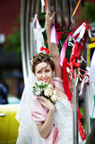 Elegant Bride at metal installation in park Royalty Free Stock Photography