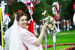 Elegant Bride at metal installation in park Royalty Free Stock Images