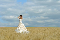 Elegant bride with red cloth Royalty Free Stock Image