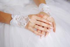Elegant bride's hands with golden ring Stock Image