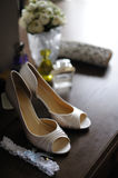 Elegant bride's shoes and garter Royalty Free Stock Images