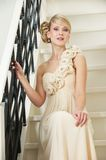 Elegant Bride Sitting on Stairs Royalty Free Stock Photography