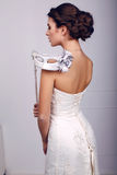 Elegant bride in wedding dress with mask in her hands Royalty Free Stock Image