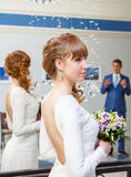 Elegant bride in wedding palace with her groom on background Royalty Free Stock Photography