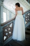 Elegant bride in a white dress standing on the Stock Photography