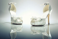 Elegant Brides white shoes Royalty Free Stock Photography