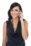 Elegant brown haired model talking on the phone Royalty Free Stock Photography