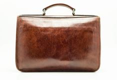 Elegant brown leather briefcase. Isolated on a white background with a clipping path. stock photo