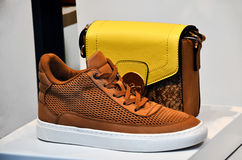 Elegant brown sneaker  with yellow handbag Royalty Free Stock Photography