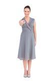 Elegant brunette in classy dress pointing at camera Stock Image