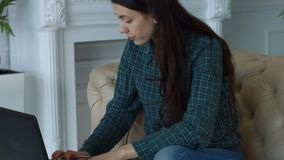 Elegant freelance woman working on laptop at home stock video footage