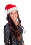 Elegant brunette girl with Christmas hat Stock Photos