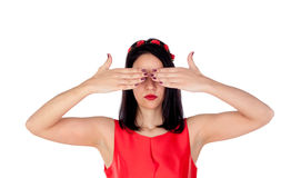 Elegant brunette girl with a red flower crown covering her eyes Royalty Free Stock Photos