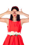 Elegant brunette girl with a red flower crown covering her eyes Royalty Free Stock Photo