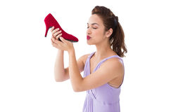 Elegant brunette kissing a shoe Stock Photography