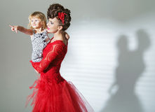 Elegant brunette lady with cheerful child Stock Photography