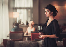 Free Elegant Brunette Lady In Black Evening Dress With Glass Of Red W Stock Photography - 85131302