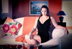 Elegant Brunette Lady inside guest house Royalty Free Stock Images