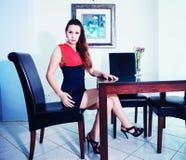 Elegant Brunette Lady inside guest house Stock Image