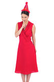 Elegant brunette in red dress preparing a secret party Royalty Free Stock Photo