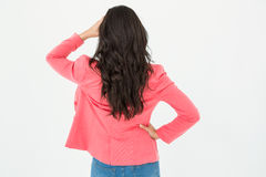 Elegant brunette standing back to camera and looking away Stock Image