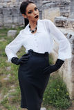 Elegant brunette wears white shirt, leather skirt and gloves Royalty Free Stock Image
