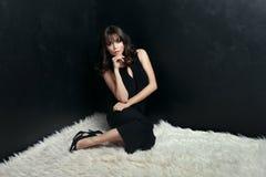 Elegant brunette woman in black dress. Stock Photos