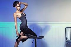 Elegant brunette woman in fashion pose Stock Image