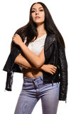 Elegant brunette woman in jeans with a leather jacket stock images