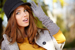 Elegant brunette  woman  in a park in autumn Stock Photo