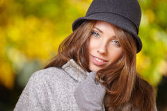 Elegant brunette  woman  in a park in autumn Royalty Free Stock Photo
