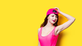 Elegant brunette woman in pink swimsuit and fashion cap. la Royalty Free Stock Images