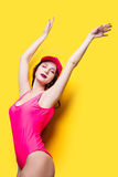 Elegant brunette woman in pink swimsuit and fashion cap. la Stock Photo