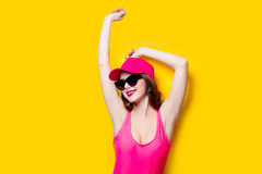 Elegant brunette woman in pink swimsuit and fashion cap. Sexy la Royalty Free Stock Photo