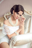 Elegant brunette woman portrait. Retro lady with fashion pearls Royalty Free Stock Image