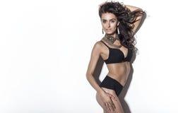 Elegant brunette woman posing in underwear. Stock Image
