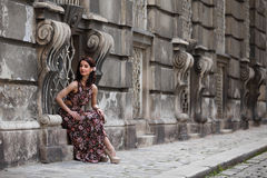 Elegant brunette woman on the street of a European city Royalty Free Stock Images