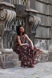 Elegant brunette woman on the street of a European city Stock Image