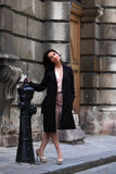 Elegant brunette woman on the street of a European city Royalty Free Stock Photography