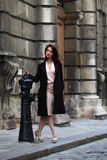 Elegant brunette woman on the street of a European city Stock Photography