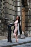 Elegant brunette woman on the street of a European city Royalty Free Stock Photos